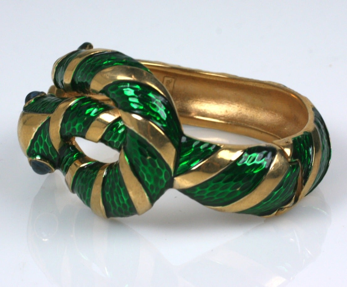 Trifari Enamel Snake Bangle with bands of emerald green transluscent enamel and faux sapphire cabochon eyes. 1960's USA.