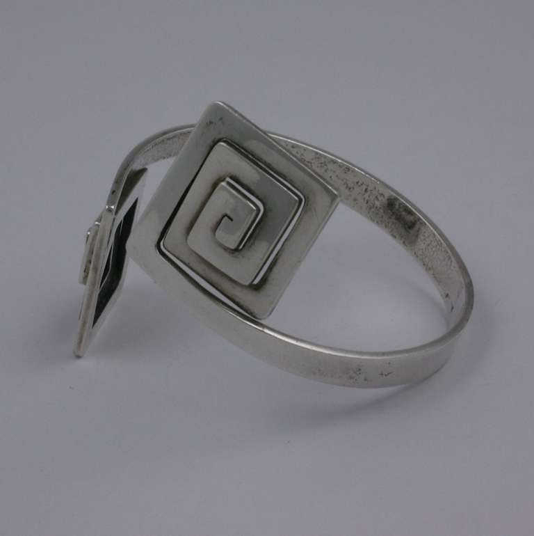 Greek Key Modernist Cuff by Puig Doria, Spain. Heavy gauge sterling is handcut into crossover Greek Key terminals which can be adjusted by squeezing bracelet band> Elegant and striking. Spain 1970's. Excellent condition.    Interior diameter 2.5