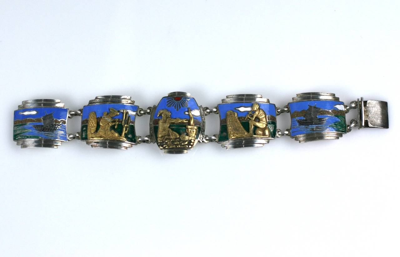 Beautiful and unusual Art Deco Panel bracelet in sterling silver with hard enamel and bronze/brass applications. The 3 central panels depict scenes of Pre Columbian life in stepped Art Deco frames. The backgrounds are beautifully enameled in color