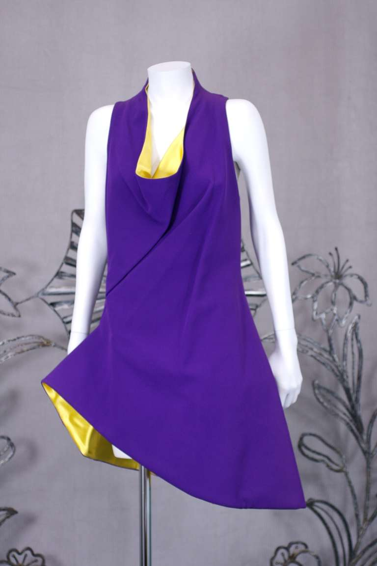 Gianni Versace bright purple wool blend faced with chrome yellow satin short evening dress. Cowl neckline and asymetrical front draping forming the permanently wind swept effect across bodice and skirt. New with tags.