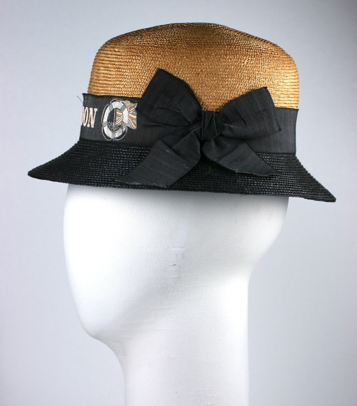 Charming Straw 2 toned hat from the early 20th Century, Advertising ribbon has