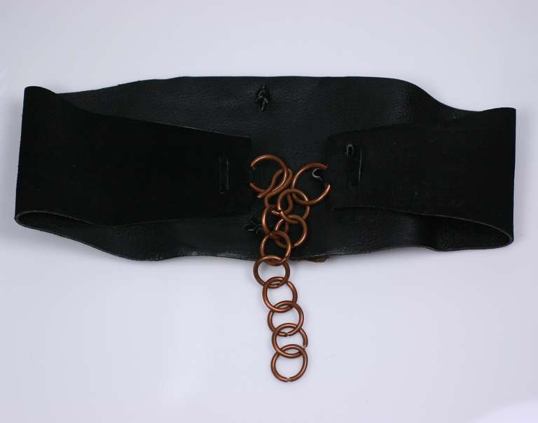 Hand hammered massive copper Butterfly motif belt on navy suede base which closes in back.  5