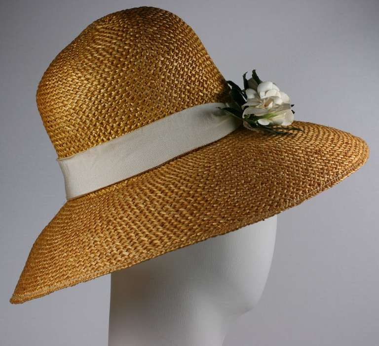 Madame Paulette woven natural straw handmade Haute Couture large brimmed hat. Trimmed with ivory grosgrain band and couture quality handmade cotton gardenias.