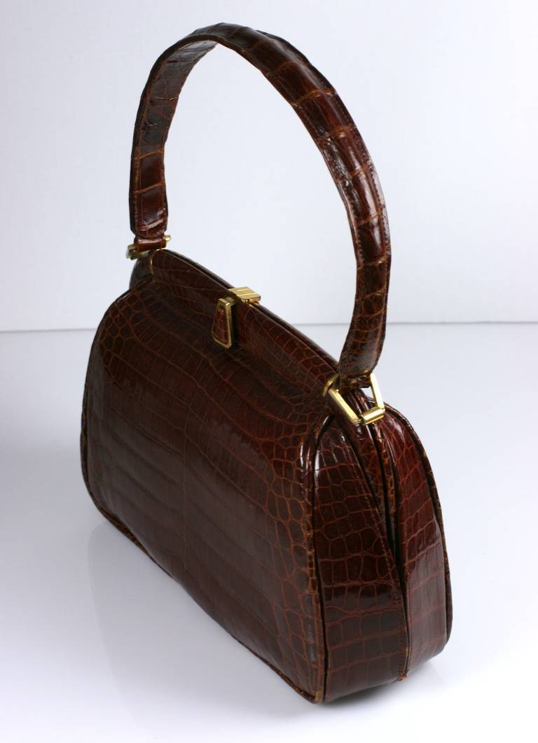Attractive French russet brown alligator center cut bag by Josef, France. High quality manufacture and lovely modern style. Lined in calf. 1950's France.  Body; 11