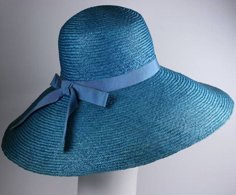 "Hubert de Givenchy classic ""Breakfast at Tiffany's"" silhouette 1961 Haute Couture large brimmed straw hat of deep aqua. with silk grosgrain band and bow.