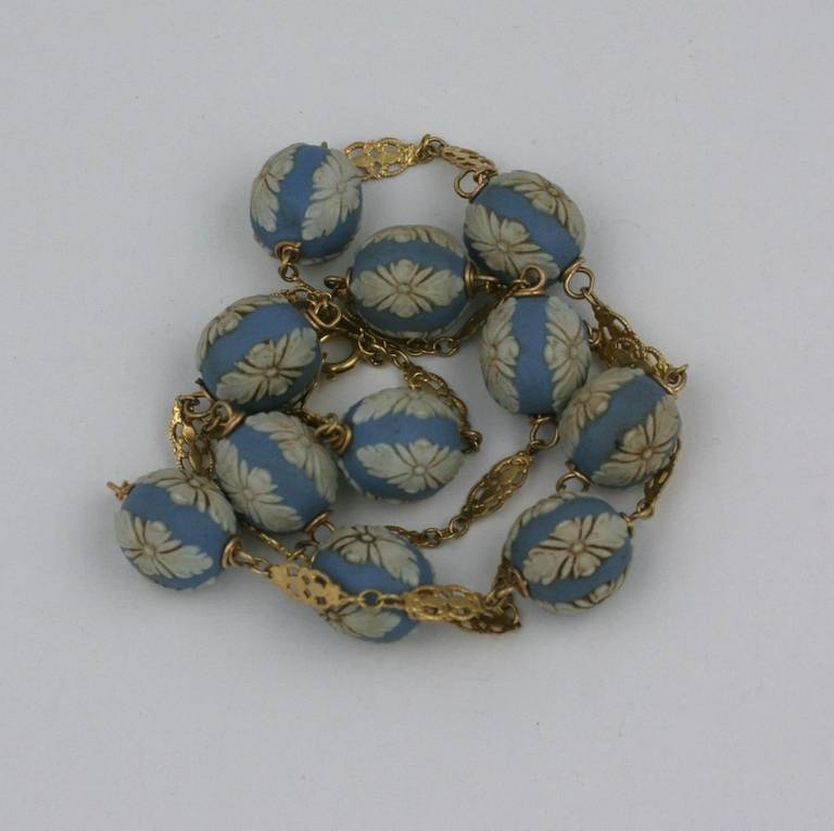 Antique Wedgewood beads set onto a 14k gold chain. Beads are 10mm in diameter, wire wrapped onto 14k gold filigree links. Beads are likely from the late 19th Century, remounted in the early 20th Century.  20