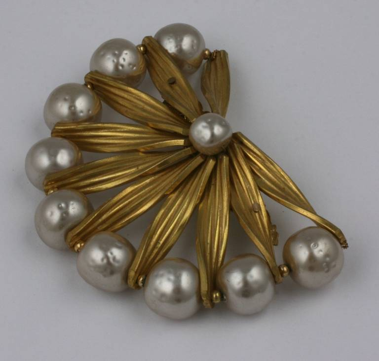 Miriam Haskell's russian gold and signature baroque pearl semi circular brooch.