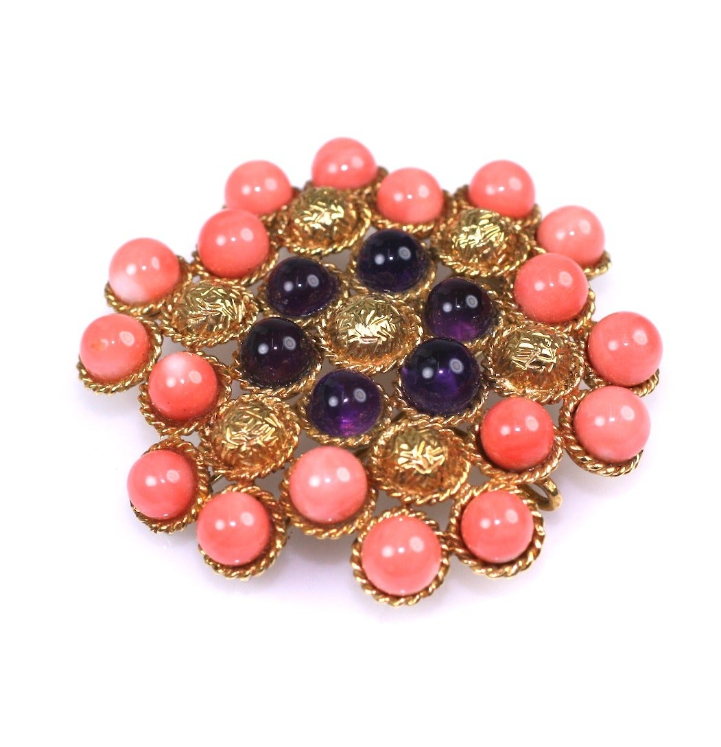 Lovely textured 18K gold cabochon clip with coral and amythest spheres.  Double clip fitting for stability as well as a pendant hook. 1960's. 2.25