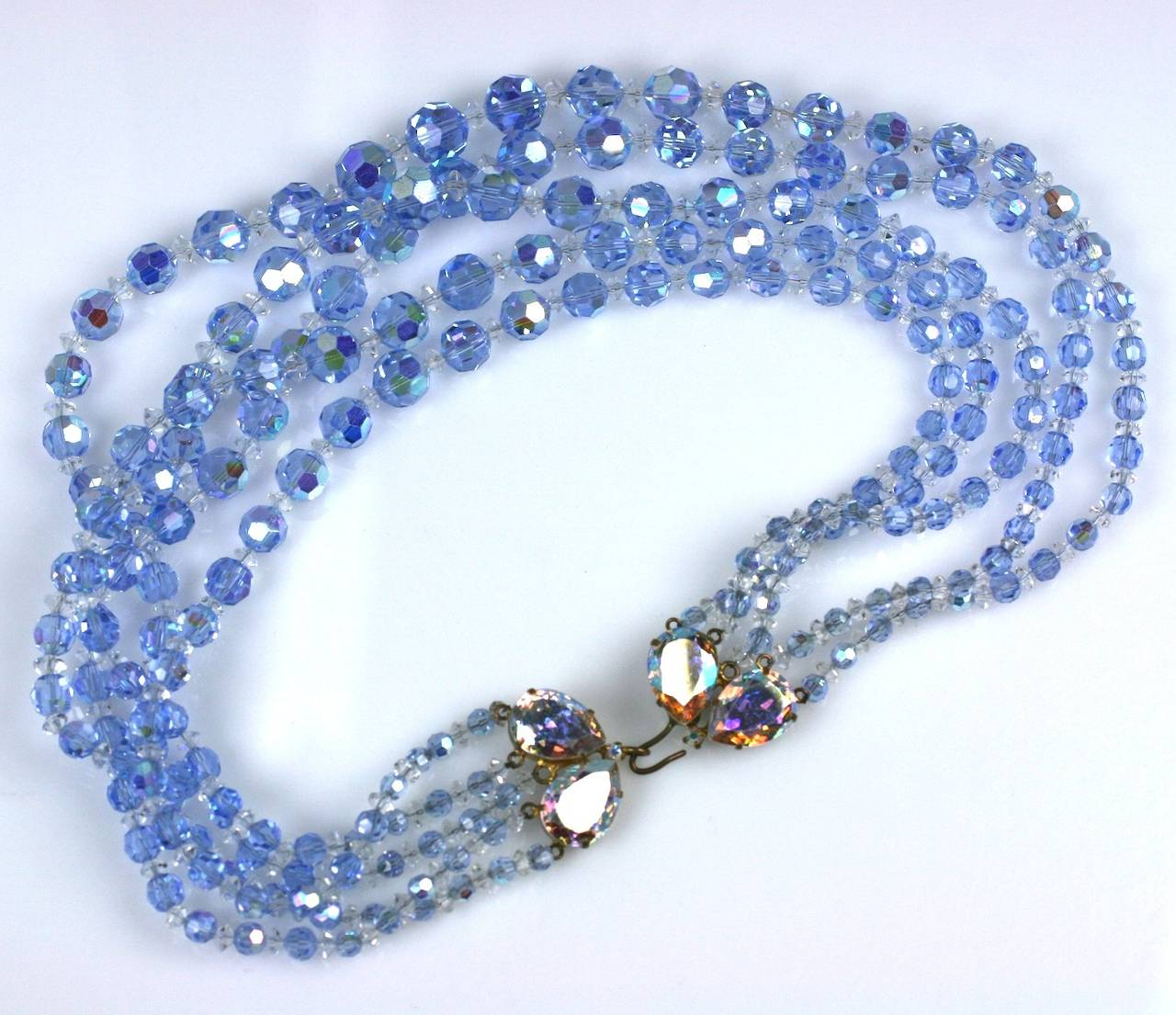 5 Strand pale aqua aurora crystal necklace of graduated beads with large pear shaped Swarovski aurora clasp. 1950's  Austria. Excellent condition. 