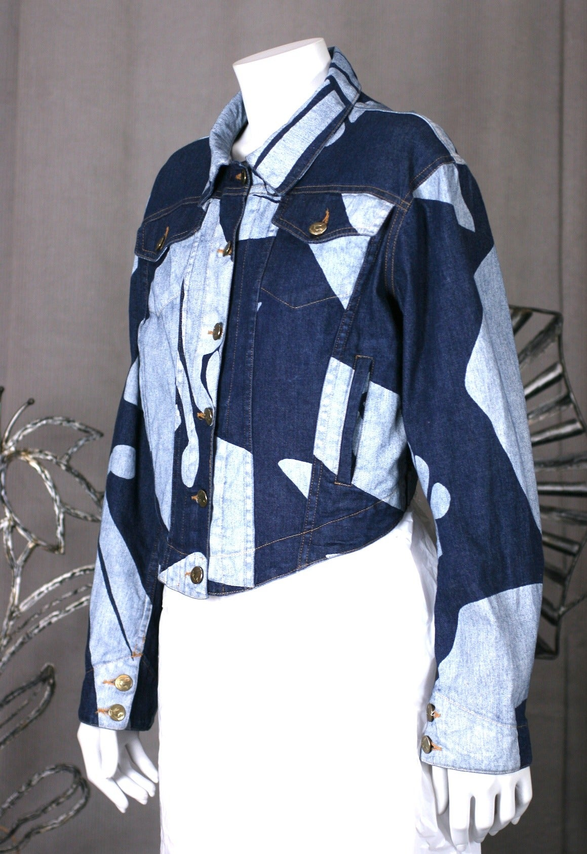 Vivienne Westwood Denim jacket, cut with 18th Century corset seaming. The master of historical fashion revisits the denim jacket, in a more fitted shape with a dipping curved hem. The denim is printed in white with her signature