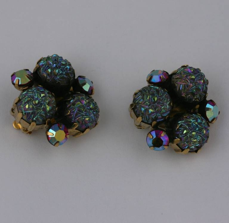 "Elsa Schiaparelli's iridiscent lava stone and aurora borealis earrings with clip back fittings. Antique gold finish. 1950's USA. Earrings 1""."
