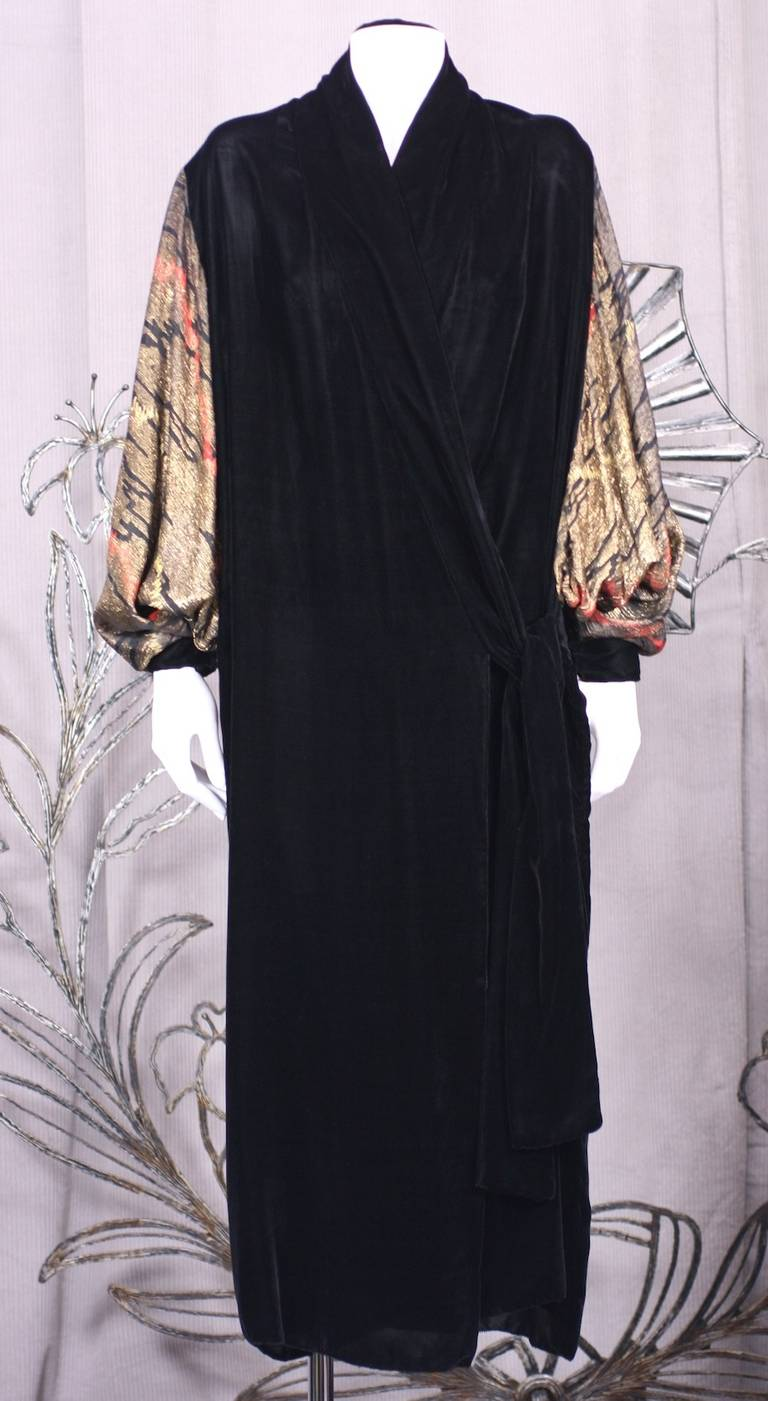 1920s Kimono inspired  dolman wrap Opera coat.The body of the coat is made of black chiffon velvet, the deep dolman sleeves of Japanesque patterned lame broche in a Deco zig zag pattern. Self ties on the left side of the coat. France 1920's.