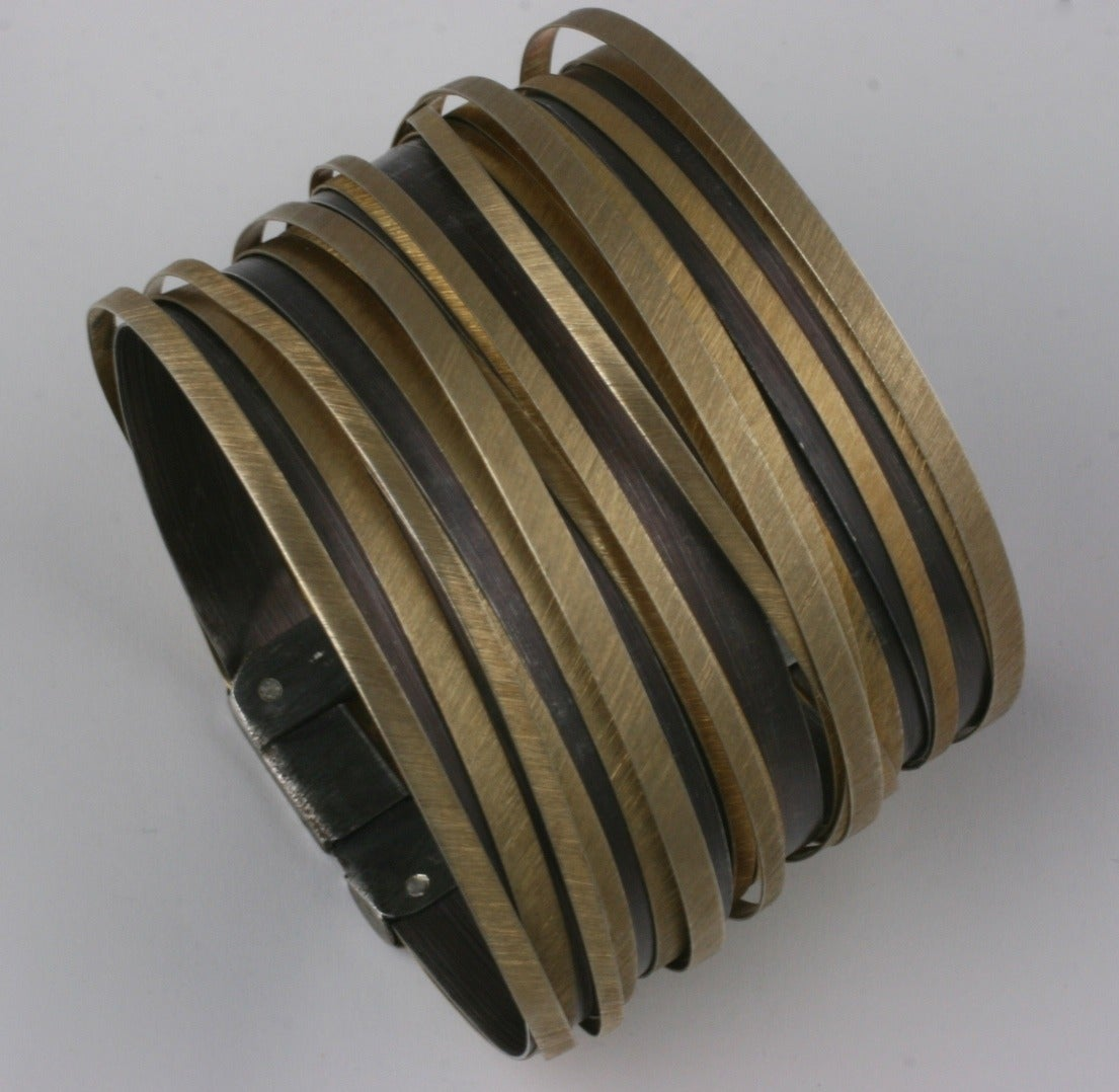 """Artisan sterling """"Strap"""" cuff gilded in 2 tones of bronze and brass. European in manufacture, this design works well for both men and women.  There are 2 layers of spliced sterling. The lower is bronze plated and the upper is brass plated."""