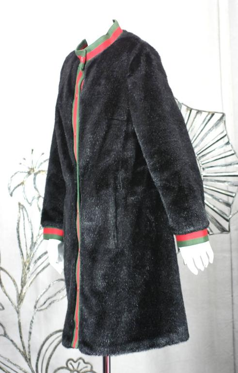 Before Calvin Klein established himself as an American Modernist designer, his company produced coats on 7th Ave. American manufacturers looked to Europe back in the day and this coat is obviously influenced by Gucci.  This Calvin Klein faux seal