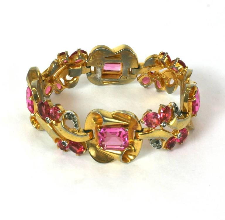 Mazer Brothers Retro style faux pink tourmaline link bracelet of gold plated metal and crystal  pave.  Excellent Condition. 1940's USA. 