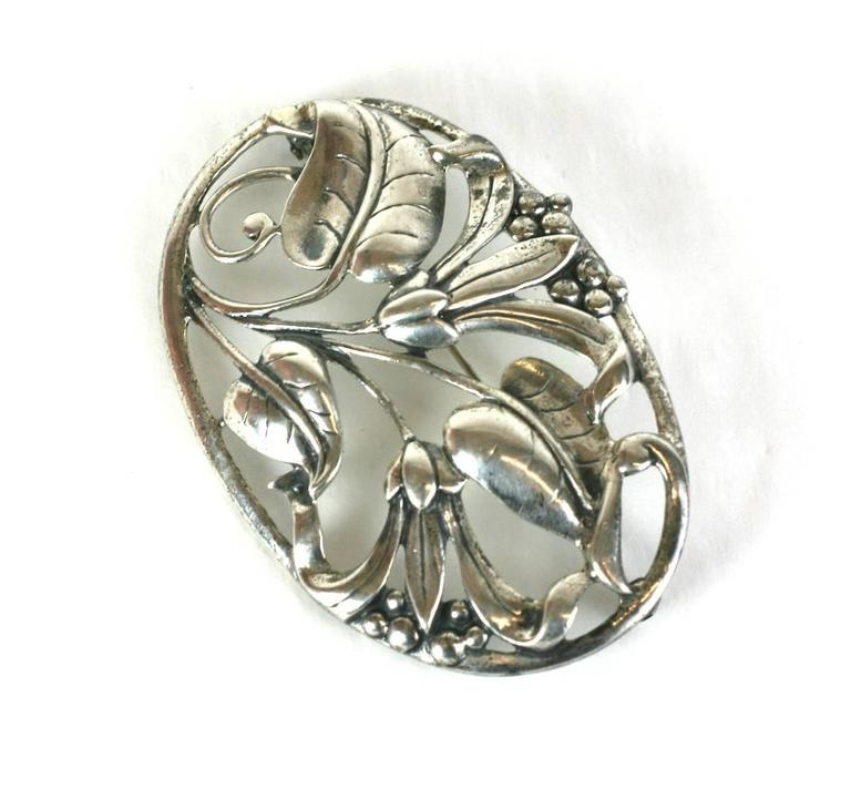 "Heavy Danecraft cast sterling silver Floral Brooch, multi blossoms, leaves and berries are set within an oval framework resembling branches. Length 3"", Width 2"". 1940's USA. 