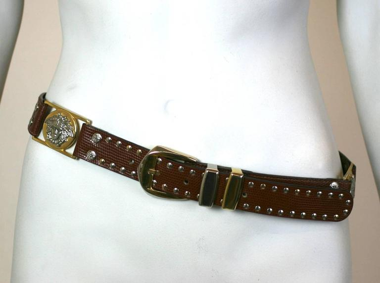 """Gianni Versace Studded Medusa Mens Belt in brown leather with silver and gold toned decoration. 1990's Italy. Excellent condition.  Size 34"""". Fits Waist 32""""-36"""". Total Length 40"""" x 1.25""""."""