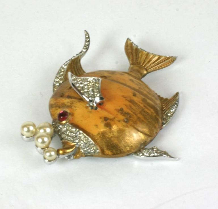 Charming and collectable Trifari Angelfish brooch with pearl bubbles and pave rhinestone accents. Unusual finish which is hand painted with gold highlights with the addition of particles on the glaze for texture. Glass pearl bubbles. Rhodium back