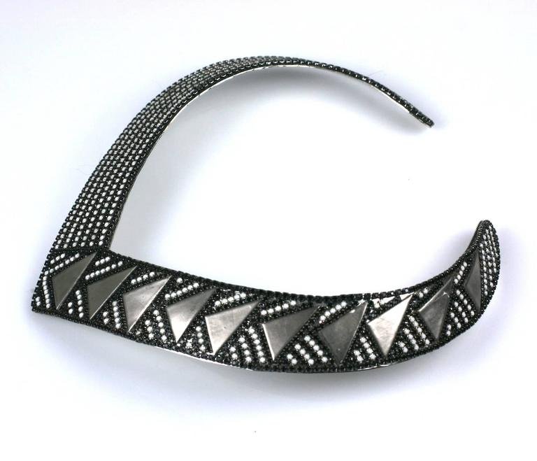Roxanne Assoulin Deco Style Collar from the 1980's is embellished with chalk and jet rhinestone strips manipulated with silvered metal triangles. Attractive and easy to wear. 1.2