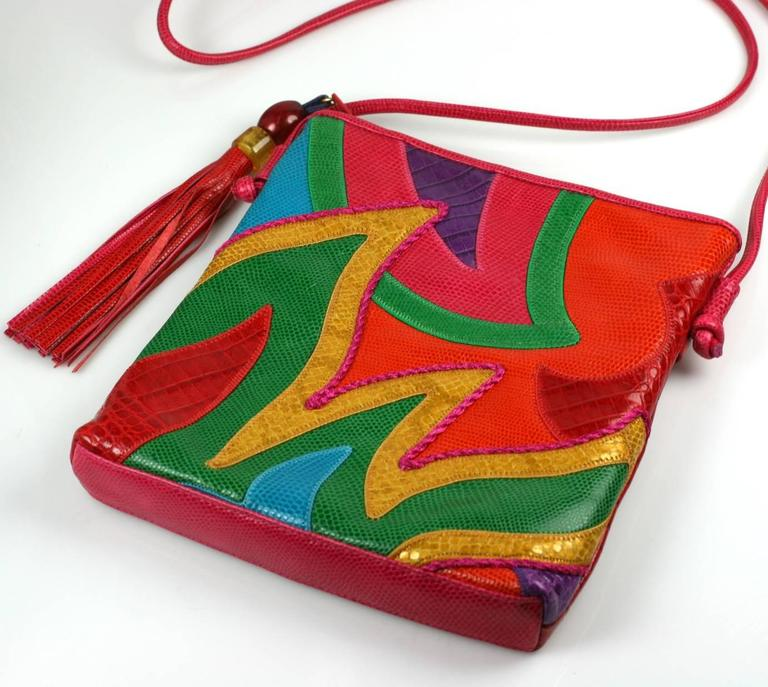 "Sharif Pieced Shoulder Bag in brilliant multicolored shades in snake and croc grained leathers with large tasseled zip charm. Hidden zip pocket on back. 1980's USA. Excellent condition.   8"" x 9"",  Strap 44"""