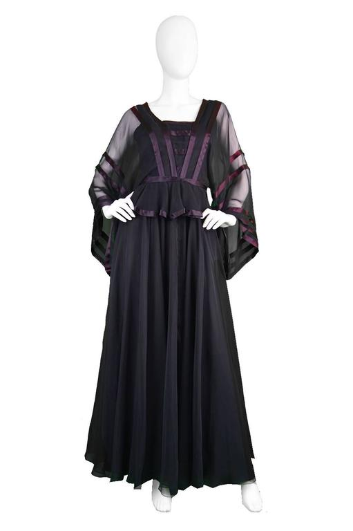 An incredible vintage evening gown from the 1970's by genius and increasingly collectible vintage British designer, Jean Varon (aka John Bates). With wide, almost kimono style sleeves in a black chiffon, with a satin trim which almost gives an