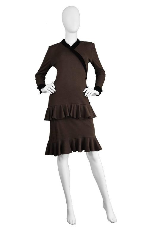 A playful yet sophisticated vintage dress from the late 70s/ early 80s by iconic designer, Oscar de la Renta for his 'Miss O' line. In a brown knit fabric with a black velvet trim highlighting the neckline and cuffs. The silhouette is fitted at the