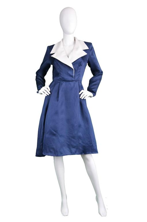An incredibly chic and elegant vintage dress from the 1980s by legendary French fashion house Givenchy for their luxurious 'couture' line. In an unusual, blue organza fabric with a white linen collar. Made in France, this luxurious dress is light