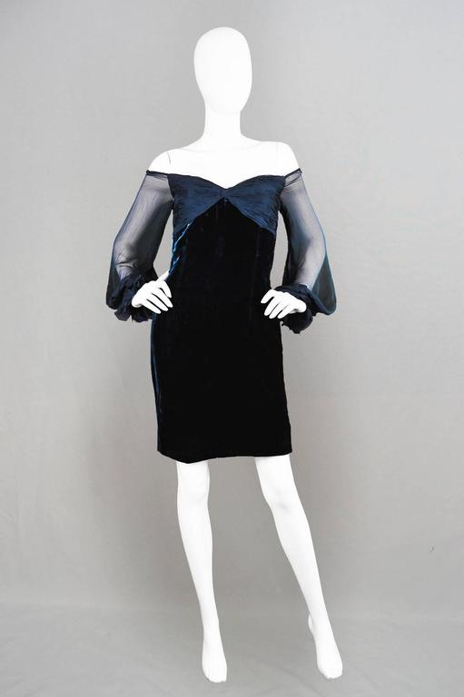A stunning vintage party dress by Valentino for their boutique line, from the A/W 1991 collection. In a silky blue velvet with a ruched bust and sheer silk chiffon off the shoulder sleeves, creating a glamorous look with loads of sex appeal.