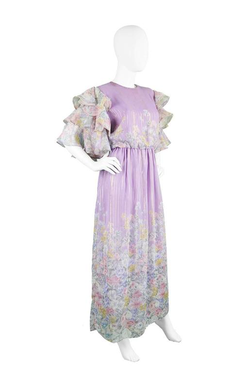 A truly spectacular vintage maxi dress by legendary Japanese designer, Hanae Mori from the 1980's. Mori's fashion inspiration comes from the butterfly, instead of being overt in the print, this dress looks to have been inspired by the creature