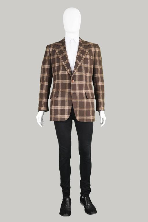 A sophisticated and superbly tailored vintage men's blazer/ sport coat by luxury French label, Lanvin. In a luxurious, brown camel hair fabric woven in Scotland with a classic checked/ plaid pattern throughout. The 70s flair and eccentricity of this