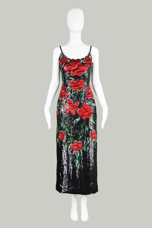 An exquisite couture vintage evening dress from c.the 1990's by Italian designer, Renato Balestra. Incredibly glamorous, constructed in black, red and green sequins on a silk backing with hand embroidery throughout, creating a floral pattern. The