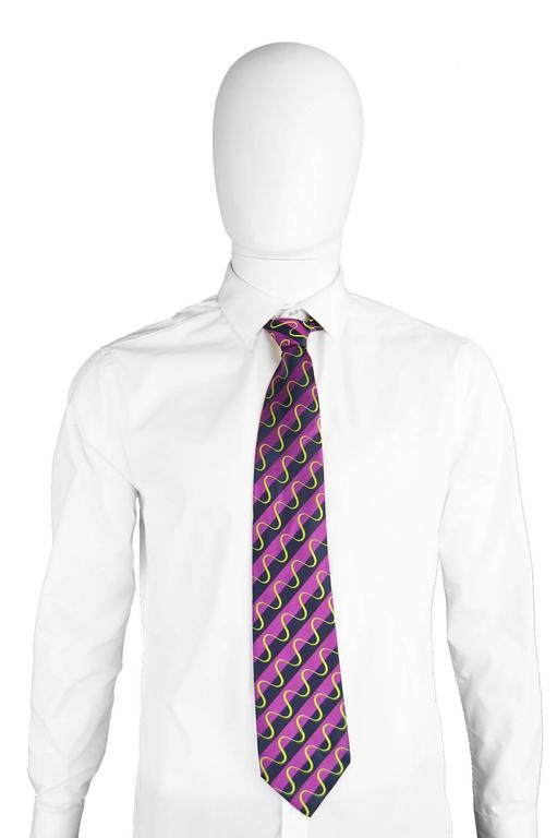 A stylish and elegant vintage men's necktie by iconic British designer, Paul Smith. With a 1970s inspired green silk embroidery on a purple and black silk. This tie would make a perfect gift for him. 