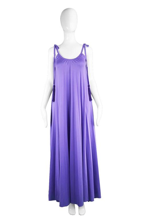 A breathtaking vintage evening gown from the 1970s by iconic British label, Frank Usher,. In yards of the incredibly flattering, fluid, synthetic jersey that Frank Usher is renowned for using in the 70s because it drapes so perfectly. A vibrant