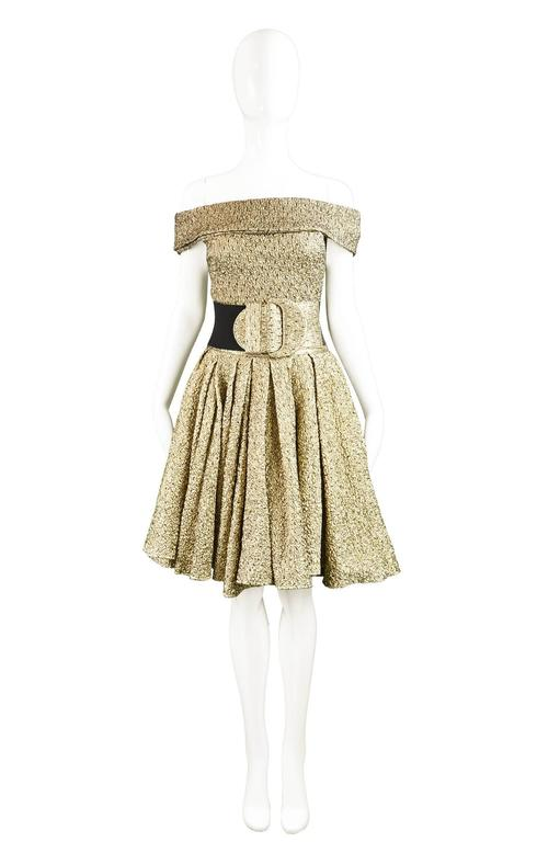 A breathtaking vintage women's ensemble from the late 1970s/ early 80s by luxury Italian designer label, Pancaldi & B. The fabric is incredible in a textured matelassé / quilted metallic gold lame with a very light and supple black tulle overlay
