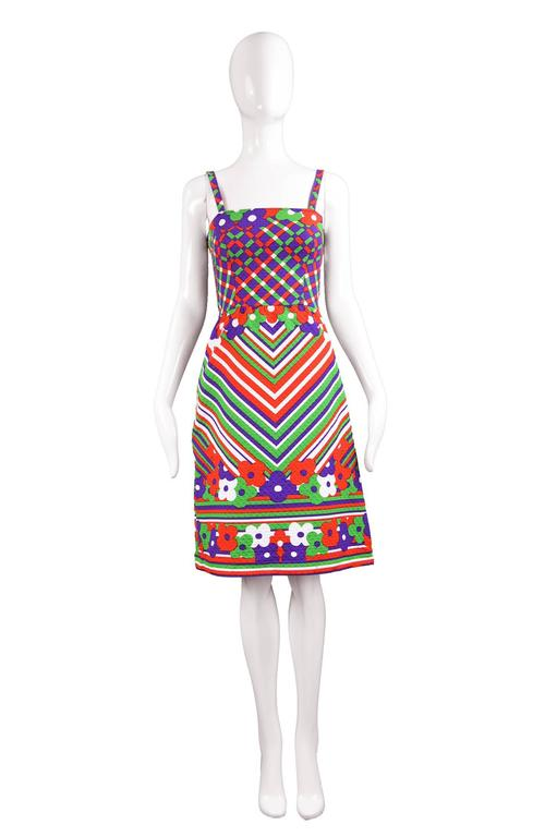 An incredibly cute vintage dress from the 1970s by Lanvin Paris in a quality quilted / textured cotton that Lanvin used quite frequently in the 70s that is breathable and gives a great structure. The print is bold with green, purple, red and white