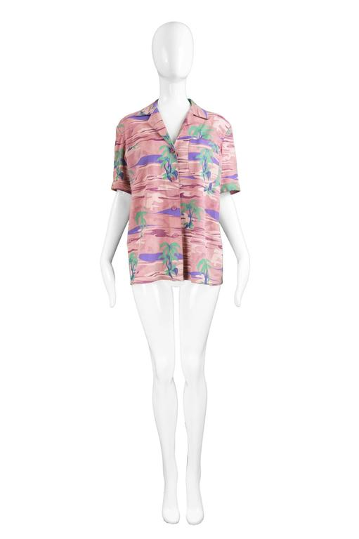 """Roberto Cavalli Vintage Pink Tropical Island Printed Suede, 1970s  Size: Marked L but looks good worn with an oversized fit on smaller sizes.  Bust - 40"""" / 101cm Length (Shoulder to Hem) - 25"""" / 63cm  Shoulder to Shoulder - 18"""" / 46cm Sleeve"""