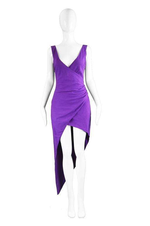 """Byblos Vintage Asymmetric Purple Linen Mini Party Dress, 1990s  Estimated Size: UK 8-10/ US 4-6/ EU 36-38 (Please check measurements).  Bust - 34"""" / 86cm  Waist - 26"""" / 66cm Hips - 38"""" / 96cm Length (Minus train) - 34"""" / 86cm  Length (To bottom of"""