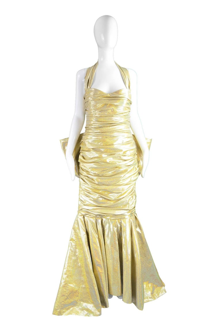 "Moschino Couture Iconic Gold 'Barbie Collection' Evening Gown, Spring 2015   Size: Marked GB 14/ US 12/ I 46 D/F 42. Please check measurements to ensure fit.  Bust - 36"" / 91cm Waist - 30"" / 76cm Hips - 40"" / 101cm Length (Bust to Hem, including"