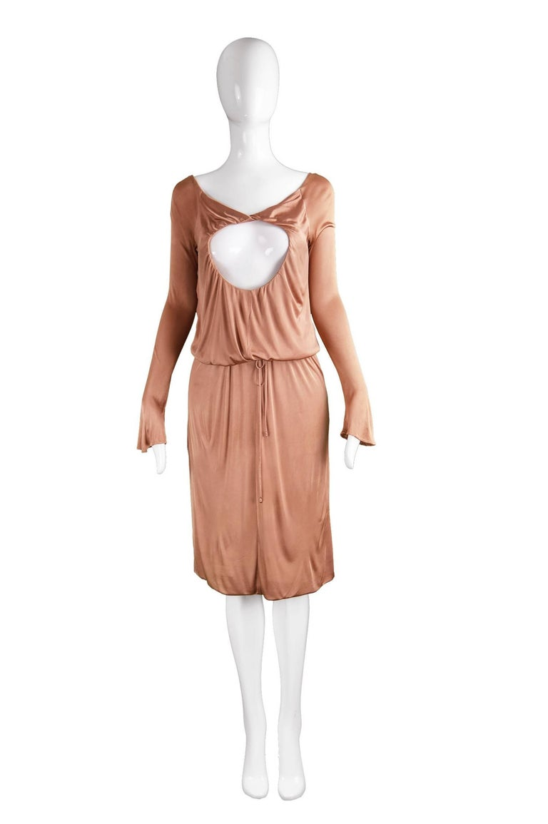 "Alexander McQueen Nude Jersey 'Pantheon as Lecum' Jersey Dress, A/W 2004  Size: Marked 38 which is roughly a UK 10/ US 6. Please check measurements. Bust - 34"" / 86cm Waist - Up to 32"" / 81cm (Can be pulled in with drawstring) Hips - 40"" /"