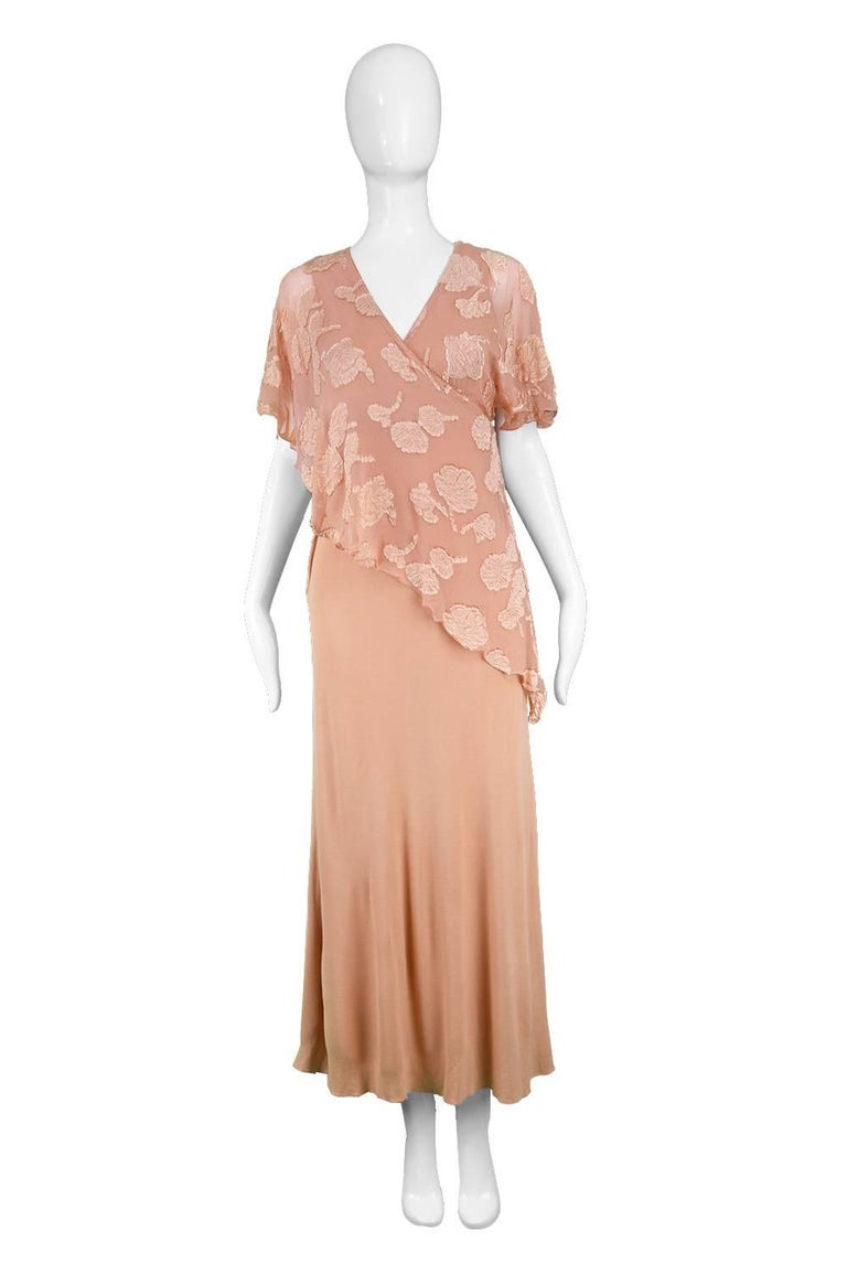 "Janice Wainwright Peach Devore Chiffon & Jersey Asymmetric Maxi Dress, 1970s  Estimated Size: UK 8-10/ US 4-6/ EU 36-38. Please check measurements. Bust - Stretches up to 34"" / 86cm Waist - 28"" / 71cm Hips - Up to 40"" / 101cm Length (Shoulder to"