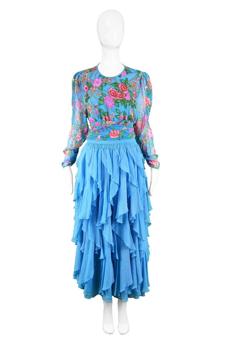 """Diane Freis Vintage 1980's Beaded Blue Ruffle Silk Floral Georgette Dress  Estimated Size: UK 12-14/ US 8-10 / EU 40-42. Please check measurements.  Bust - 40"""" / 101cm (meant to have a loose, blouson fit around bust) Waist - stretches up to 34"""" /"""