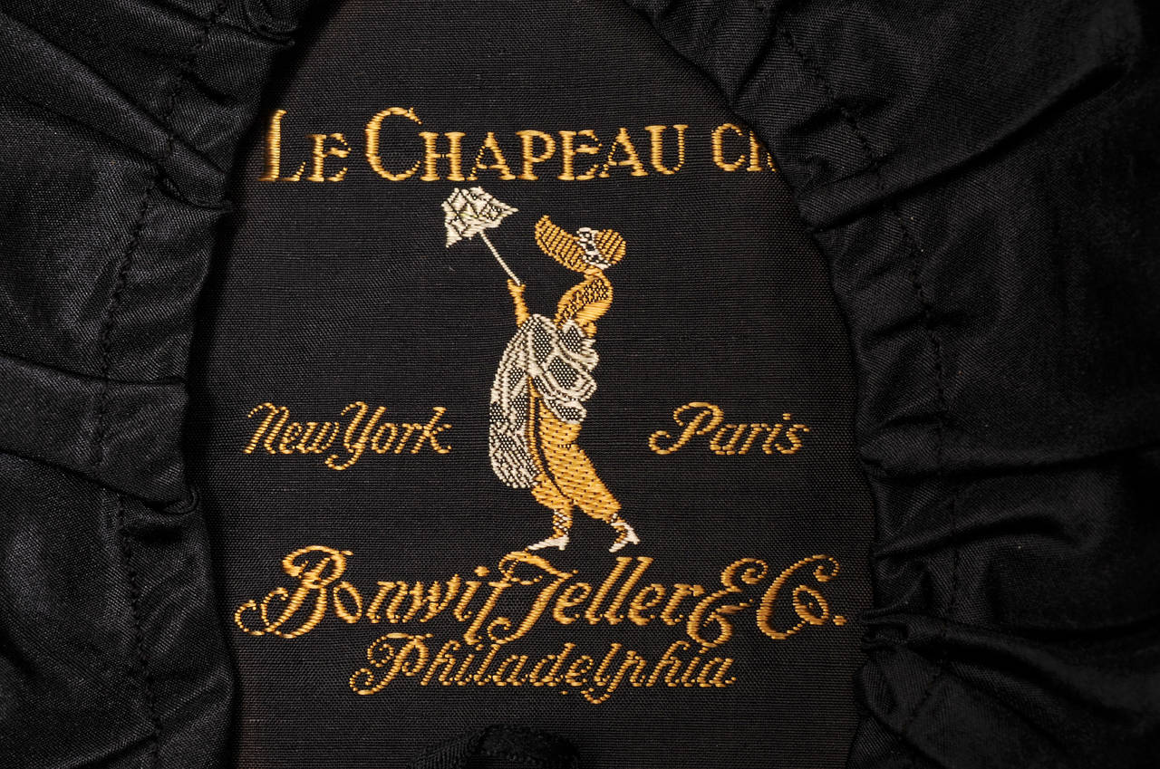 1920's Le Chapeau Chic, Bonwit Teller Black Straw Cloche For Sale 1