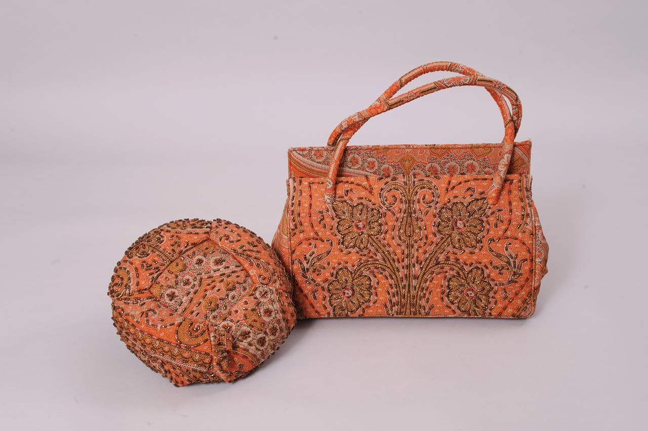 Laddie Northridge was a well known and respected milliner from the 1930's though the 1950's. This beaded paisley hat & bag is a rare example of a matching set.