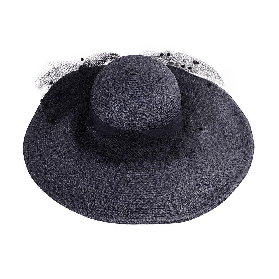 Vintage 1950's Broad Brimmed Navy Blue Straw Hat For Sale