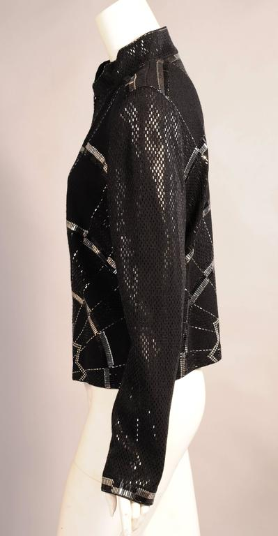 An Art Deco inspired bold and graphic design is worked in silver and black on this chic black wool jacket. Long flat black and silver bands, small silver dots, rhinestones and black sequins are all used in the design. The jacket has a zippered