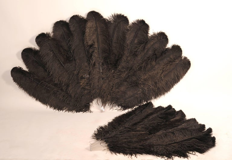 From the Paris atelier of the late Patrick Kelly these oversized Lucite and black ostrich feather fans are just so glamorous.  They were used on the runway during the Autumn Winter 1989 collection. The Lucite sticks almost disappear into the