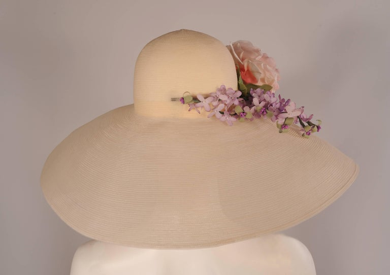 This beautiful ivory horse hair hat has a very generous brim to protect you from the sun or prying eyes, it was custom made for my client by her friend Patricia Underwood.  The hat is elegantly trimmed with a large spray of lavender flowers and a