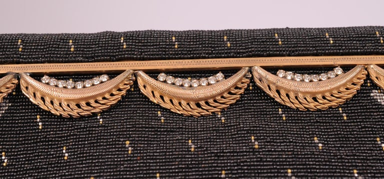 Langlois & Jargeais< Paris are the creators of this stunning black beaded  evening bag. The workmanship is truly breathtaking. The very smallest micro beads are used in shades of black, gold, silver and copper all done by hand in France. The bag has