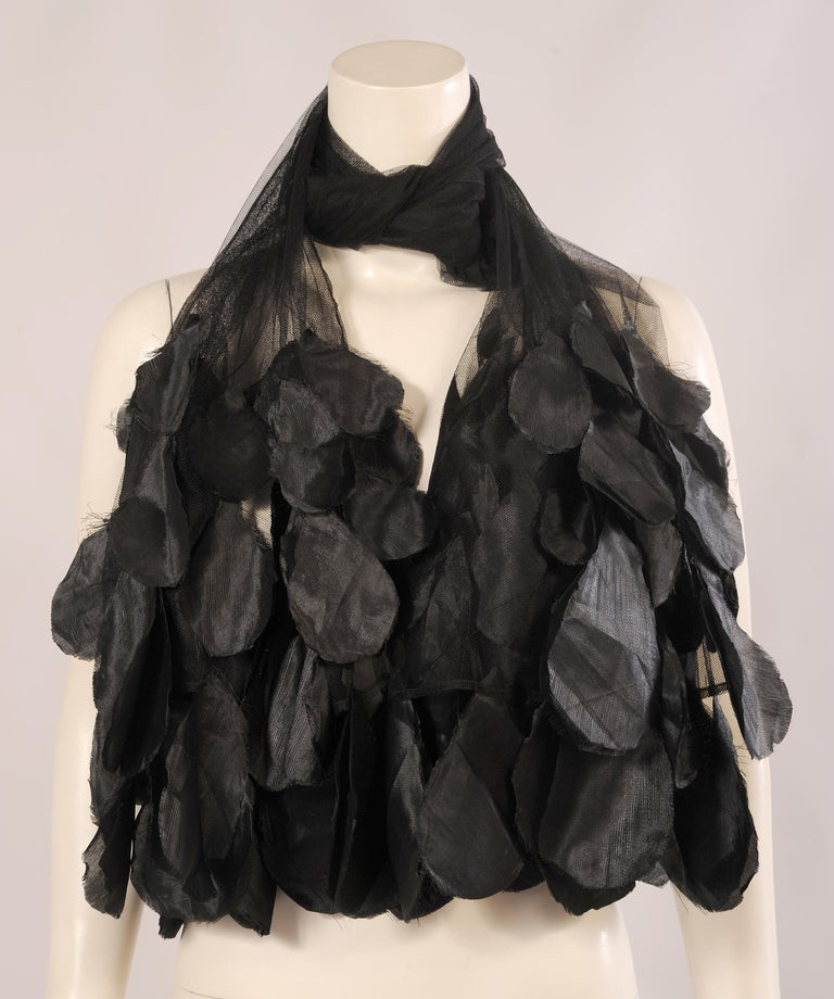 This ultra feminine tulle shawl is embellished with black silk flower petals at each end. The tulle is in perfect condition and one size fits all. Measurements; Length 84