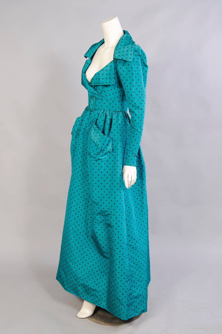 Deep chocolate brown polka dots on teal blue silk create a striking and unusual evening dress with a low cut neckline from Givenchy Haute Couture. The gown has a portrait collar and a faux wrap top. There are zippers and snaps on both sides of the
